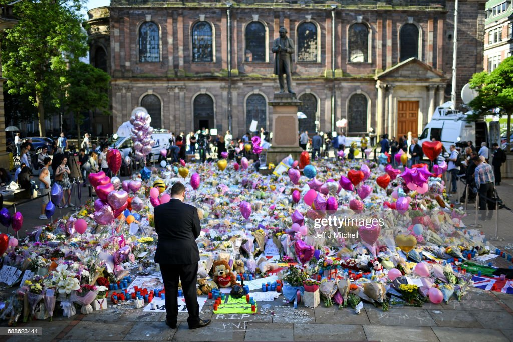 Floral Tributes Are Left For The Victims Of The Manchester Arena Terrorist Attack : News Photo