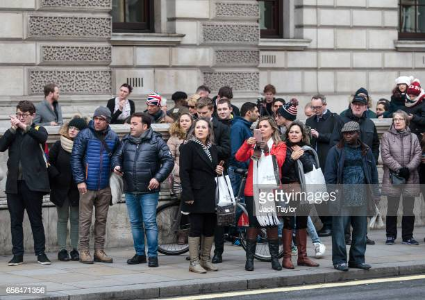 Members of the public look on as roads are closed off by Police around Westminster Bridge and the Houses of Parliament on March 22 2017 in London...