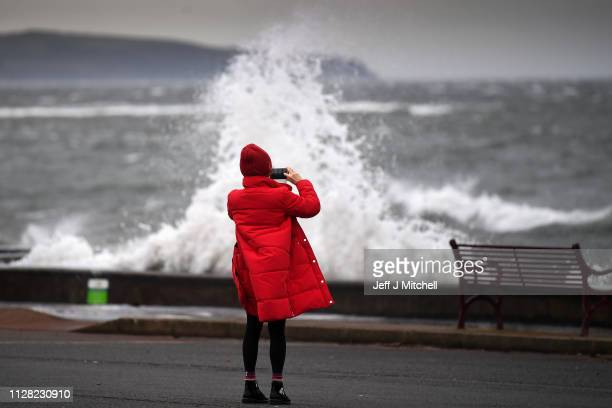 Members of the public look on as Storm Erik makes landfall with winds of up to 70mph due to hit some areas of the UK along with heavy rain on...