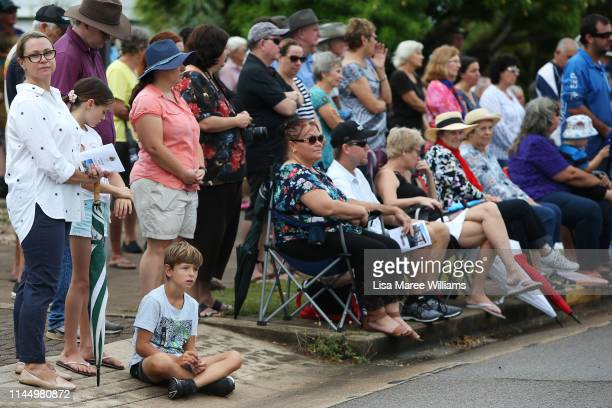 Members of the public look on during a ANZAC service at Bowen Cenotaph on April 25 2019 in Bowen Australia Australians commemorating 104 years since...