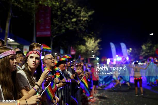 Members of the public look on during the 2018 Sydney Gay Lesbian Mardi Gras Parade on March 3 2018 in Sydney Australia The Sydney Mardi Gras parade...
