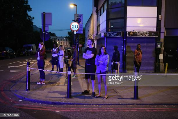 Members of the public look on near Finsbury Park Mosque after an incident in which a van hit worshippers outside the building on June 19 2017 in...