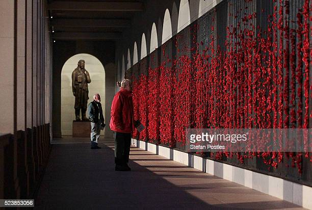 Members of the public look to place poppies on the Roll of Honour in the Australian War Memorial after the Anzac Day dawn service on April 25 2016 in...