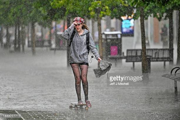 Members of the public make their way through the rain on Sauchiehall Street on August 09, 2021 in Glasgow, Scotland. Large parts of Scotland have...