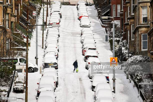 Members of the public make their way through the snow in Gardner Street on February 28 in Glasgow Scotland Freezing weather conditions dubbed the...