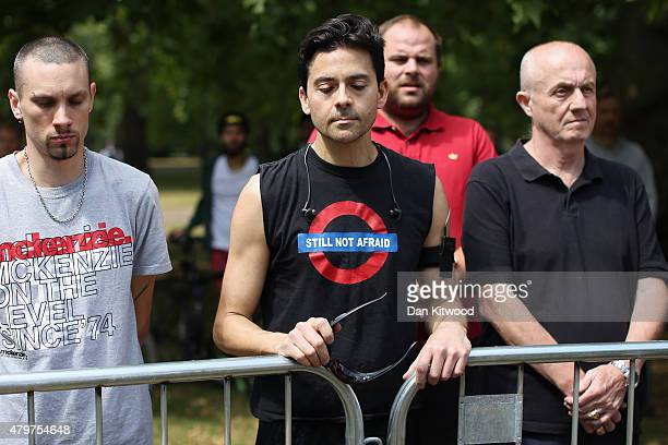 Members of the public observe a minutes silence at the memorial to the victims of the July 7 2005 London bombings in Hyde Park on July 7 2015 in...