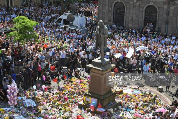 Members of the public observe a national minute's silence in remembrance of all those who lost their lives in the Manchester Arena attack, on May 25,...