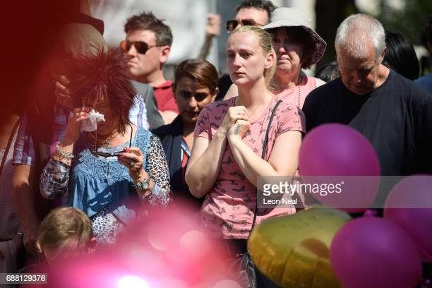 Members of the public observe a national minute's silence in remembrance of all those who lost their lives in the Manchester Arena attack on May 25...
