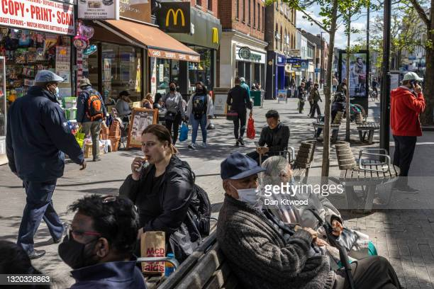 Members of the public on a busy High Street on May 27, 2021 in Hounslow, England. The London borough of Hounslow is one of eight locations around...