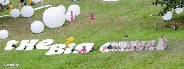 Members of the public participate in an installation by artist Spencer Tunick on Day 4 of The Big Chill Festival at Eastnor Castle Deer Park on...