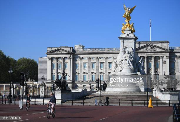 Members of the public pass Buckingham Palace on April 26 2020 in London England The 40th London Marathon was due to take place today with thousands...