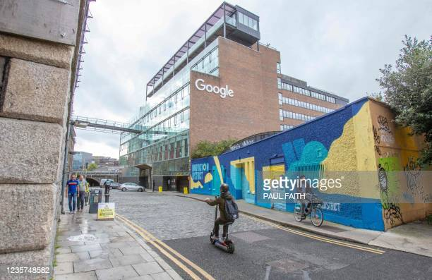 Members of the public pass the offices of Google in the business and financial sector of Dublin City centre on October 7, 2021. - The government of...