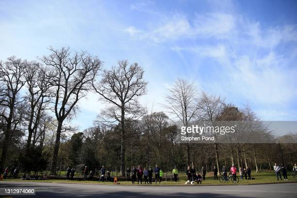 Members of the public pause for a period of silence outside The Norwich Gates at Sandringham House on April 17, 2021 in Sandringham, Norfolk. The...