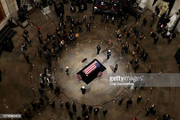 Members of the public pay their respects as former US President George HW Bush lies in state in the US Capitol Rotunda December 03 2018 in Washington...