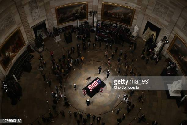 Members of the public pay their respects as former U.S. President George H.W. Bush lies in state in the U.S. Capitol Rotunda December 03, 2018 in...