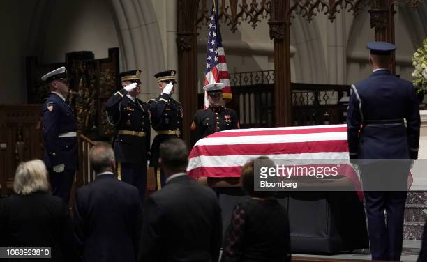 Members of the public pay their respects as the flagdraped casket of former US President George HW Bush sits on the repose at St Martin's Episcopal...