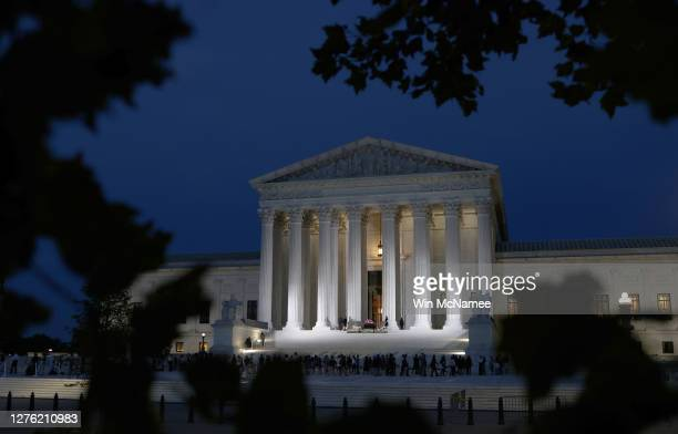 Members of the public pay their respects beneath the casket of Associate Justice Ruth Bader Ginsburg into the evening at the U.S. Supreme Court, on...