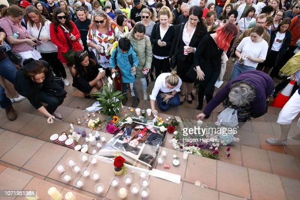 Members of the public pay their respects during a vigil for British backpacker Grace Millane at Civic Square on December 12 2018 in Wellington New...