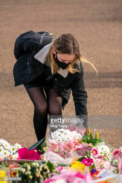 Members of the public pay their respects to Sarah Everard at the bandstand, Clapham Common, where floral tributes have been building up over the last...