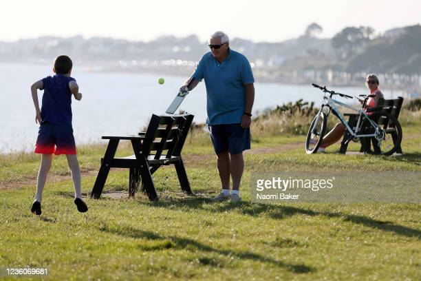 Members of the public play cricket by the beach on May 30 2020 in LeeOnTheSolent England The British government continues to ease the coronavirus...