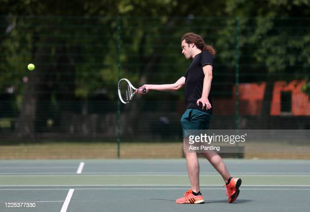Members of the public play tennis at Stratford Park Tennis Courts on May 17 2020 in London England The prime minister announced the general contours...