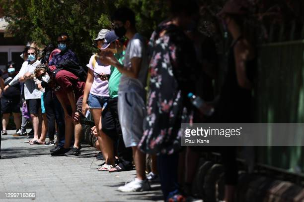 Members of the public queue at the Royal Perth Hospital Covid-19 testing clinic on February 01, 2021 in Perth, Australia. Lockdown restrictions are...