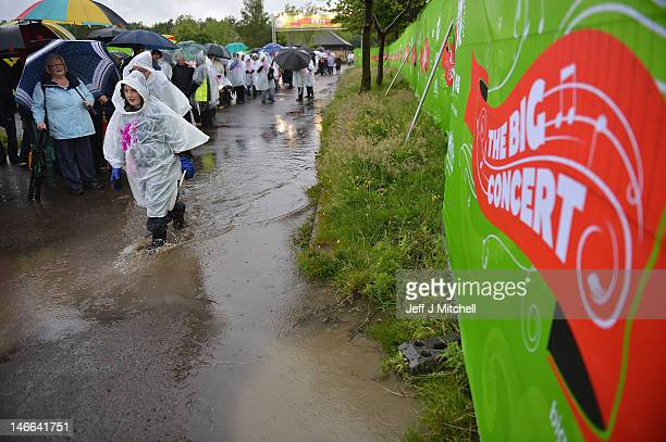 Members of the public queue in the rain for The Big Concert on June 21 2012 in Stirling Scotland The Big Concert is the opening event of the London...