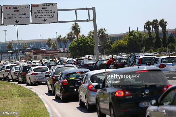 Members of the public queue in their vehicles at the border to enter Gibraltar on August 7 2013 in La Linea de la Concepcion Spain Following talks...