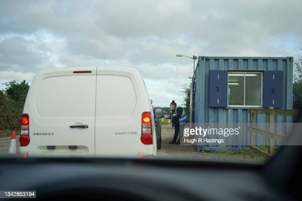 Members of the public queue in their vehicles to gain entry to the Stithians Showground temporary NHS vaccination centre during its final hour of...
