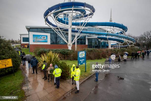 Members of the public queue outside a Covid-19 testing centre at Splash World in Southport on February 02, 2021 in Southport , United Kingdom. Health...