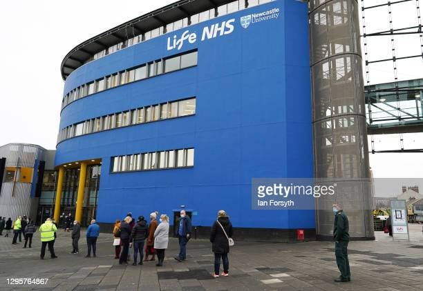 Members of the public queue outside the Centre For Life to receive the AstraZeneca/Oxford University Covid-19 vaccine on January 11, 2021 in...