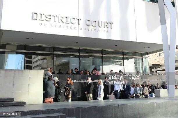 Members of the public queue outside the Supreme Court of Western Australia on September 24, 2020 in Perth, Australia. The verdicts on the man accused...