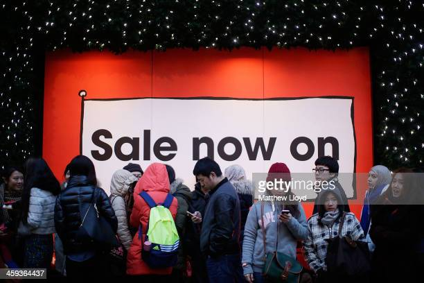 Members of the public queue round the block in anticipation of the Boxing Day sales at Selfridges on December 26 2013 in London England Statistics...