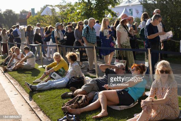 Members of the public queue to enter a show garden at Chelsea Flower Show on September 22, 2021 in London, England. This year's RHS Chelsea Flower...