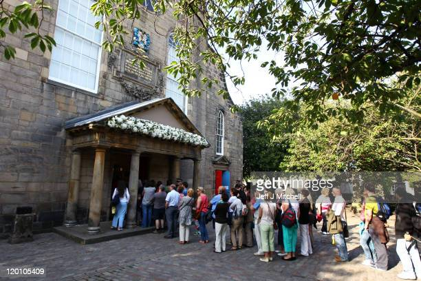 Members of the public queue to get into the church after the Royal wedding of Zara Phillips and Mike Tindall at Canongate Kirk on July 30, 2011 in...