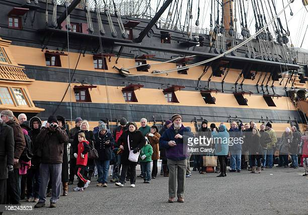 Members of the public queue to get on board HMS Ark Royal on January 22 2011 in Portsmouth England Thousands of people are expected to visit the...