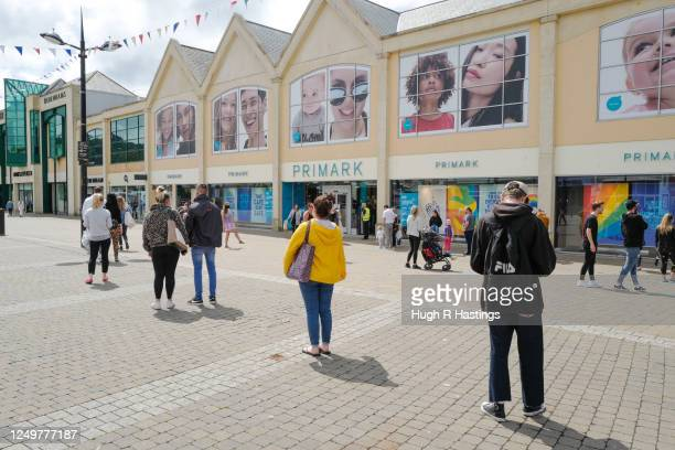 Members of the public queue to go into the Primark store at Lemon Quay, on June 15, 2020 in Truro, Cornwall, United Kingdom. The British government...