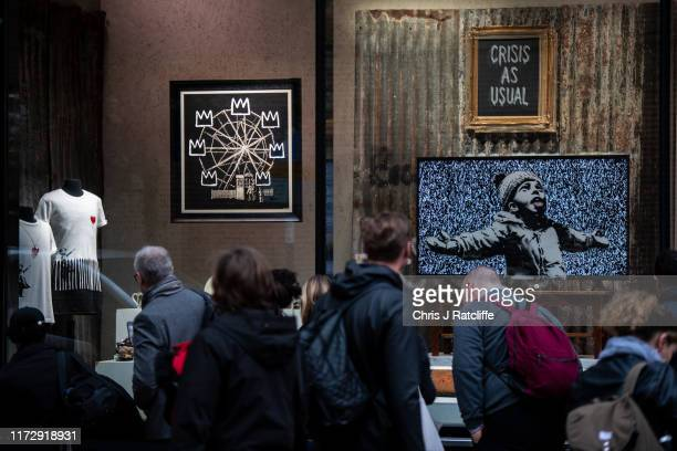 Members of the public queue to look at a new installation by elusive artist Banksy on October 1 2019 in Croydon England The shop names 'Gross...