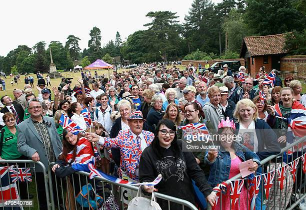 Members of the public queue up outside the Sandringham Estate and the Church of St Mary Magdalene as they wait for the Christening of Princess...