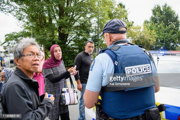 Members of the public react in front of the Masjd Al Noor Mosque as they fear for their relatives on March 15 2019 in Christchurch New Zealand One...