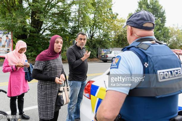 Members of the public react in front of the Masjd Al Noor Mosque as they fear for their relatives on March 15 2019 in Christchurch New Zealand 49...