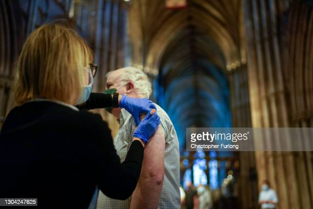 Members of the public receive their Covid-19 vaccinations at Lichfield Cathedral, Staffordshire on February 26, 2021 in Lichfield, England. Lichfield...