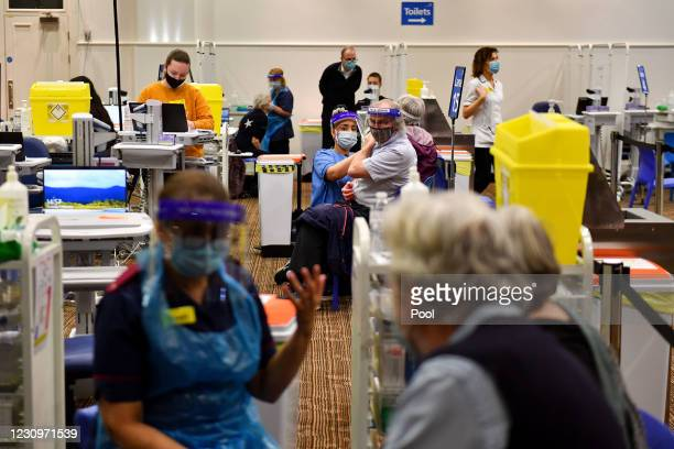 Members of the public receive their vaccinations at the new seven day vaccination centre at Villa Park on February 04, 2021 in Birmingham, England....