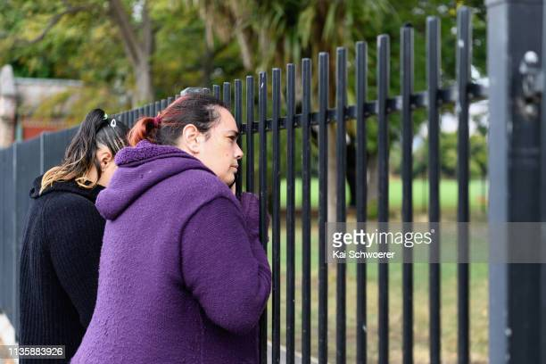 Members of the public refuse to leave without their children as their school Te Waka Unua School is in lockdown on March 15 2019 in Christchurch New...