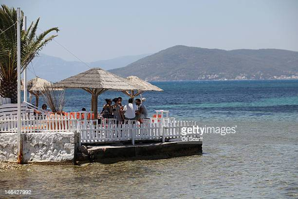 Members of the public relax in a seafront bar on the island of Aegina on June 16 2012 in Aegina Greece The Greek electorate are due to go to the...