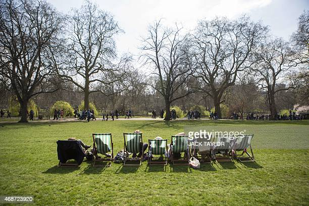 Members of the public relax in deck chairs in St James's Park central London on April 6 2015 as England basks in higher than expected temperatures on...