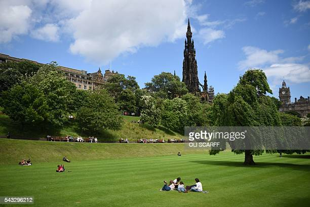 Members of the public relax in Princes Street Gardens in the city centre of Edinburgh Scotland on June 27 2016 Britain's historic decision to leave...