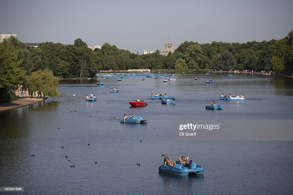 Members of the public relax on pedalos in the warm weather on Hyde Park's Serpentine lake on July 18, 2014 in London, England. The Met Office has issued a heatwave alert as temperatures soar to their highest of the year.