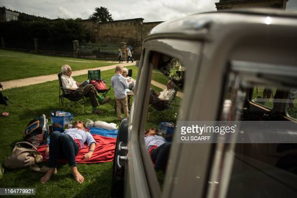 Members of the public relax on the first day of the Chatsworth Country Fair in the grounds of Chatsworth House, near Bakewell in northern England on...