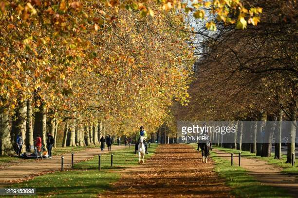 Members of the public ride horses in Hyde Park, London on November 4, 2020. - England heads into a second national lockdown tomorrow to try to cut...